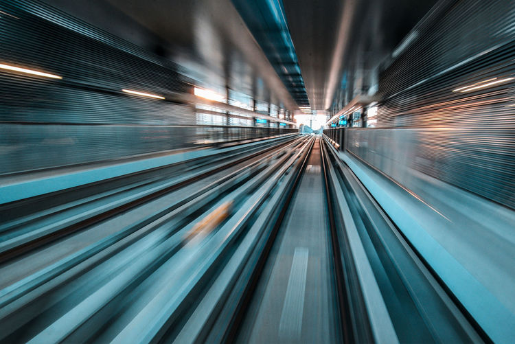 Blurred motion of railroad tracks at subway station