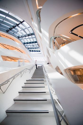 Follow me on instagram at @tillfindl Staircase Steps And Staircases Steps Indoors  Railing Architecture The Way Forward Built Structure Modern Low Angle View Futuristic Day No People Hand Rail