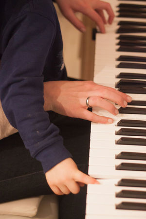 Mother and child playing the piano together Keys Piano Supporting Musicians Teaching Childhood Growing Up Help Instrument Mother And Child Motherlove Music Lesson Piano Lessons Playing The Piano Teach Togetherness