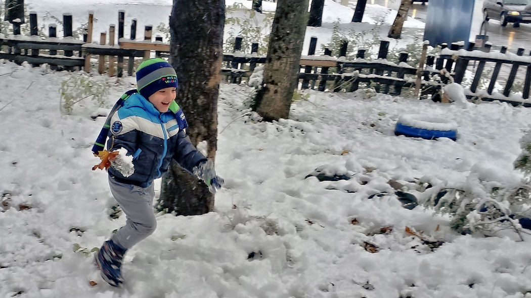 Small kid playing snow ball. Snow Ball Child Snow Child Photography