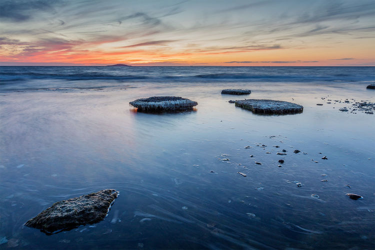 Limestone sunset Sunset Water Sunset Water Scenics Sea Tranquil Scene Beauty In Nature Tranquility Idyllic Rock - Object Nature Sky Horizon Over Water Non-urban Scene Cloud - Sky Orange Color Waterfront Majestic Remote Outdoors Seascape Öland Nature Photography Sweden Nature