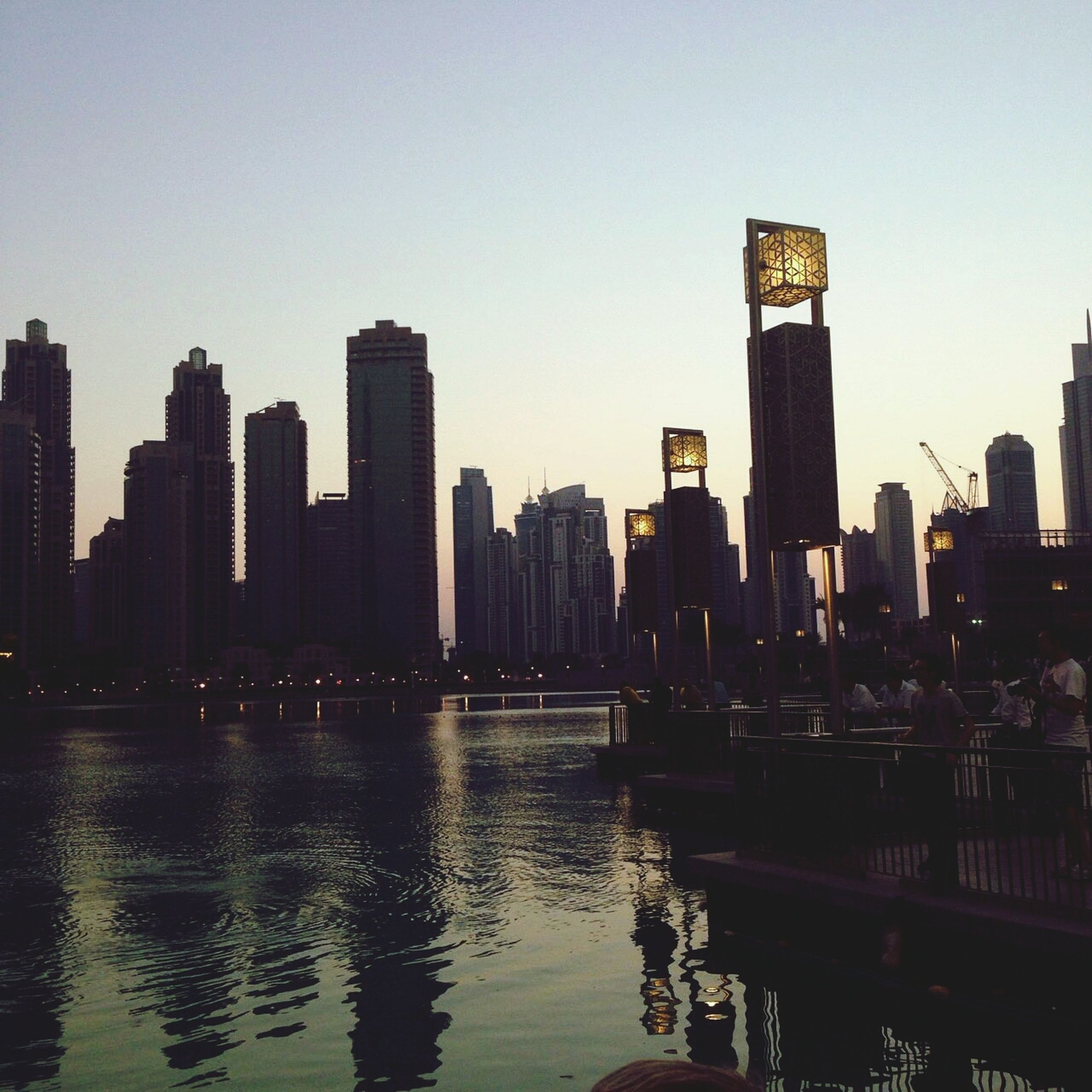 building exterior, architecture, water, built structure, city, skyscraper, clear sky, river, waterfront, urban skyline, tall - high, cityscape, tower, modern, office building, skyline, copy space, reflection, sky, financial district