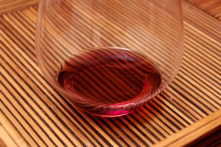 High angle view of wine in on textured tray