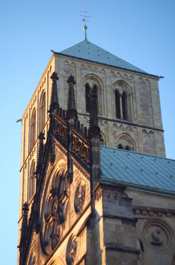 Churches in Münster, germany, during sunset Architecture Building Exterior Built Structure Religion Building Belief Place Of Worship Spirituality Low Angle View Sky Tower Day Clear Sky The Past History Nature No People Outdoors Clock Spire  Münster Münsterland