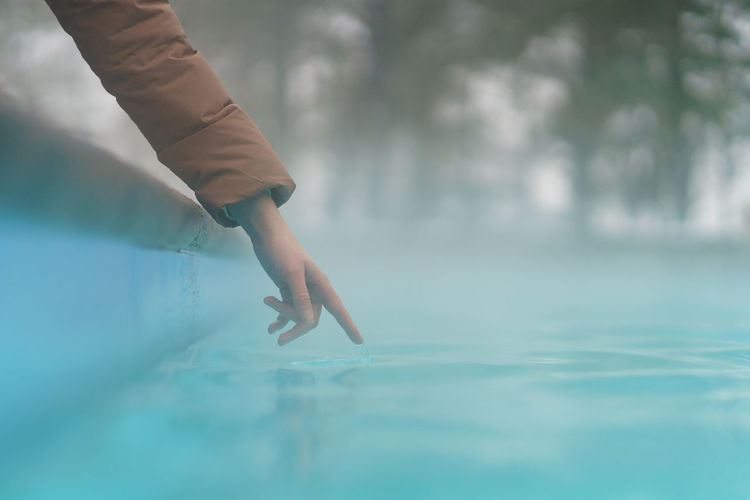 Midsection of person in swimming pool