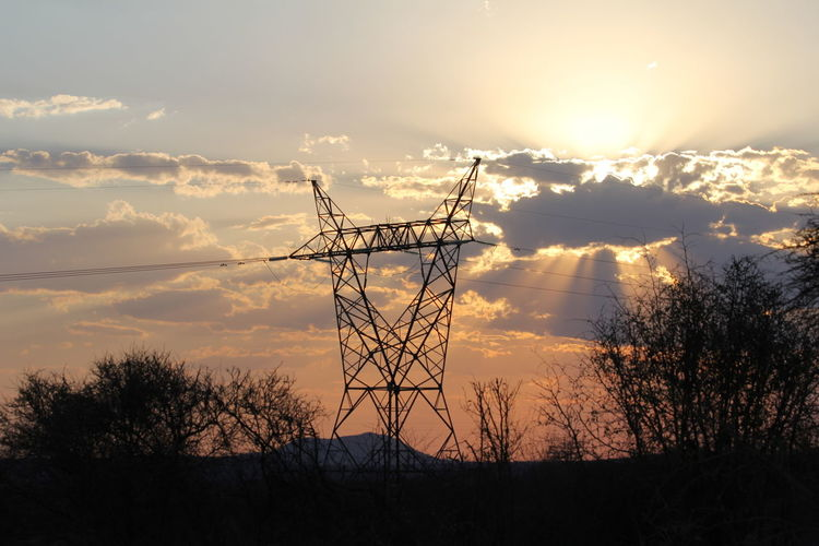 Architecture Beauty In Nature Built Structure Cloud - Sky Electricity  Electricity Pylon Low Angle View Nature No People Non-urban Scene Orange Color Outdoors Plant Power Supply Scenics - Nature Silhouette Sky Sunset Technology Tranquil Scene Tree