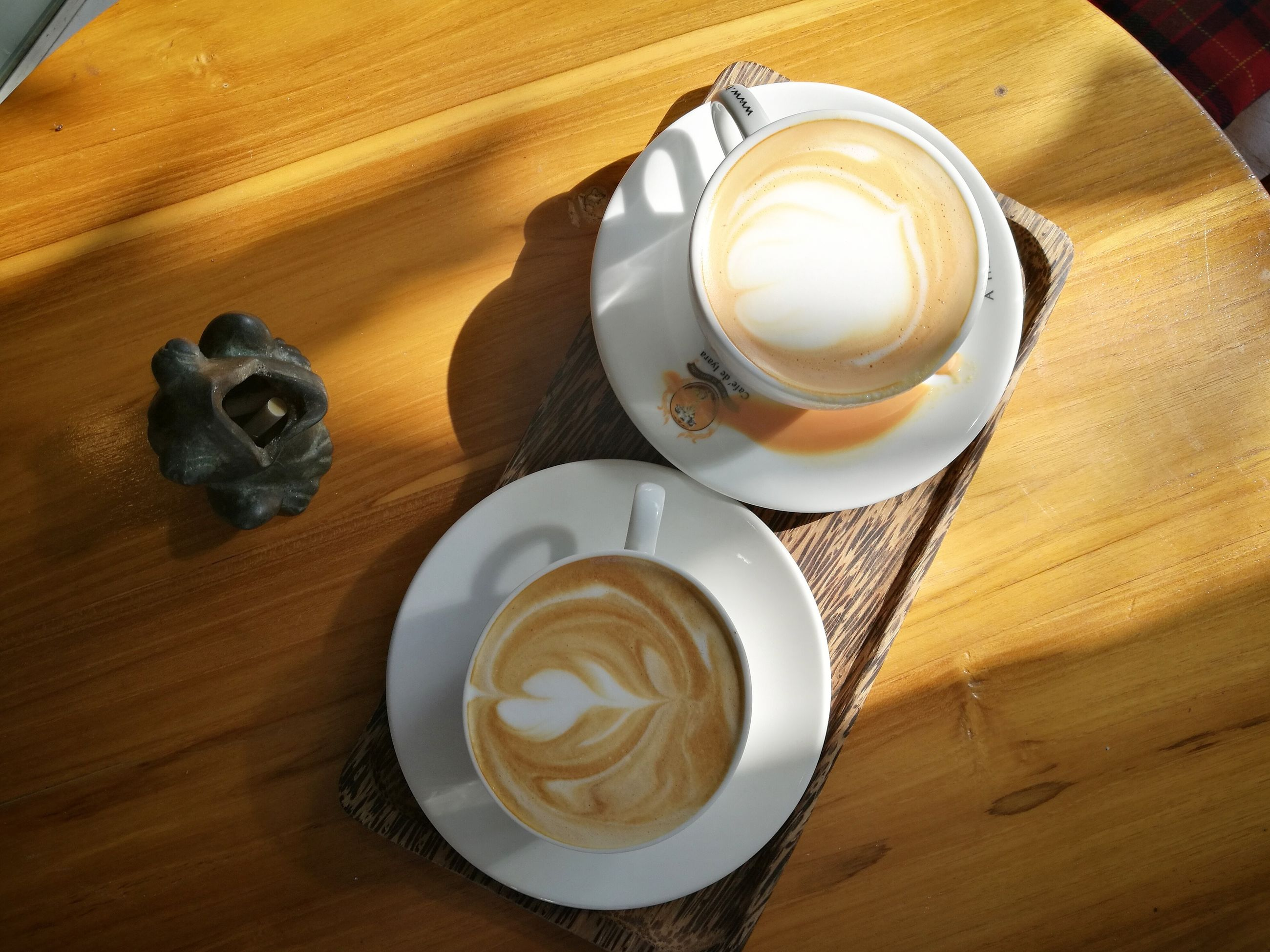 coffee cup, drink, table, coffee - drink, frothy drink, refreshment, froth art, food and drink, cappuccino, high angle view, wood - material, indoors, freshness, saucer, latte, no people, food, close-up, day