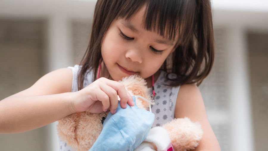 Close-up of cute girl holding toy