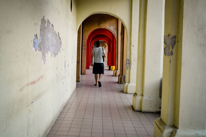 Walking Arch Corridor Full Length Indoors  Leaving Architecture One Person Rear View Adult Built Structure People Day Child Only Men Archways Travel Destinations Streets Of Penang Penang Malaysia Street Photography One Person Walking The Week On EyeEm