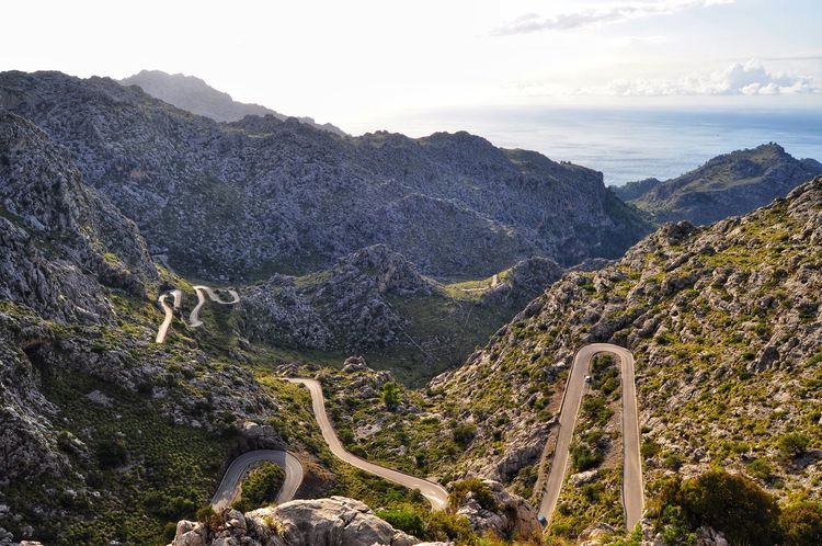 EyeEm Selects amazing mountain roads view in tramontana mountains on mallorca island in spain Outdoors High Angle View Mountain Nature Landscape Beauty In Nature Mallorca SPAIN Majorca Rock - Object Travel Destinations Scenics Mountain Road Tramontana Go Higher