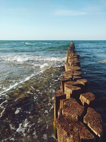 Sea Beach Horizon Over Water Water Sky Sand Nature Outdoors Blue Travel Tranquility Travel Destinations Landscape Vacations Summer Clear Sky Freedom Mindfulness Horizon Buhnen Wooden Groin Groyne Jetty Spur