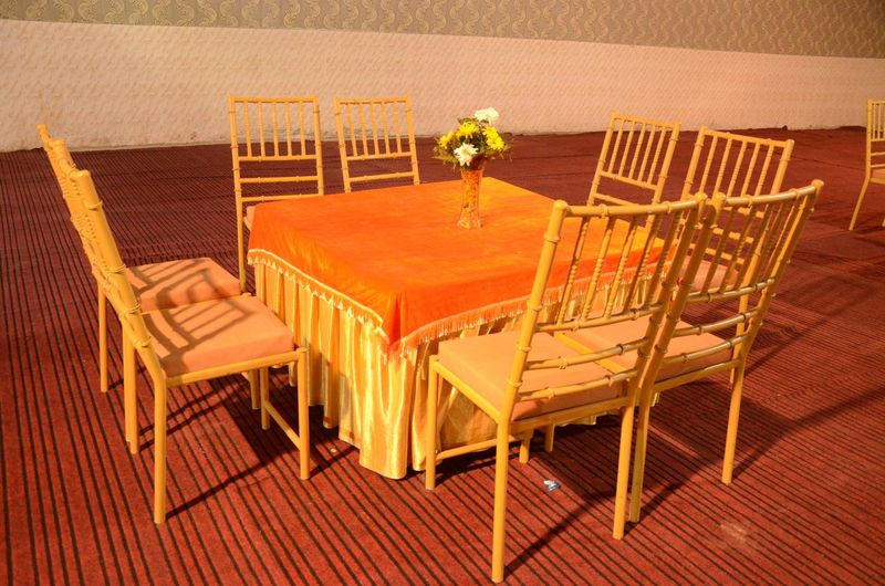 Dining table uniqueness EyeEmNewHere EyeEm Best Shots Orange Color Dining Table Happiness Wedding Ceremony Marriage  Golden Wedding Chair Seat No People High Angle View Nature Plant Architecture Built Structure Flower Table Flowering Plant Sunlight Wood - Material Pattern Furniture Flooring Empty Absence Outdoors Day