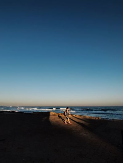 Beach Sea Horizon Over Water Sand Shore Scenics Nature One Person Water Beauty In Nature Real People Clear Sky Full Length Blue Tranquil Scene Standing Tranquility Vacations Outdoors Sky Shotoniphone7plus מייאייפון7 IPhone7Plus מייים מייבתגלים