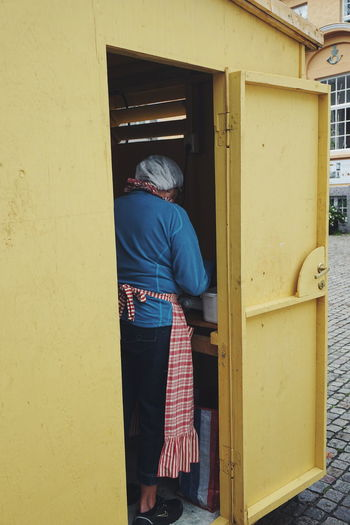 "woman making local cakes called ""munker"" Door Doorway One Person People Adult Business Finance And Industry Adults Only Built Structure Architecture Lifestyles Standing One Woman Only Women Day Only Women Human Body Part Outdoors Real People Senior Women People And Places Norwegian Summer Kiosk Shopping Standing Mandal Paint The Town Yellow"