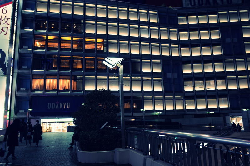 People in illuminated building at night