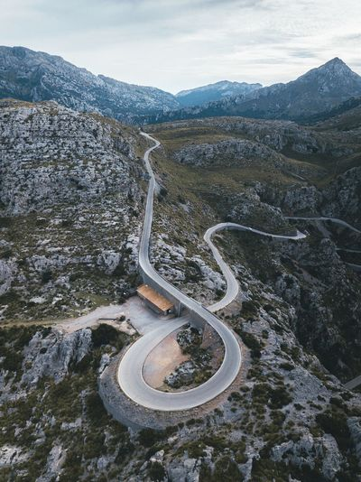 Roads in Mallorca drive me crazy. Nature VSCO Landscape Mallorca Day Nature Beauty In Nature No People High Angle View Mountain Scenics - Nature Road Land Landscape Tranquility Non-urban Scene Environment Tranquil Scene Transportation Outdoors Sky Winding Road Pattern Mountain Road