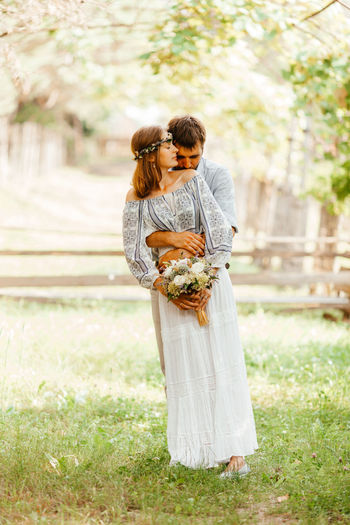 Full length of couple embracing outdoors