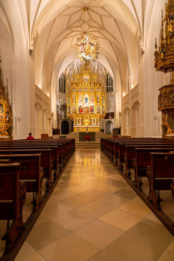 Interior shot of a church Church Architecture Indoors  Seat Place Of Worship Religion Pew Built Structure Belief Lighting Equipment Spirituality Building Illuminated Bench In A Row Flooring Ceiling Arch No People Ornate Aisle Architectural Column Tiled Floor Altar