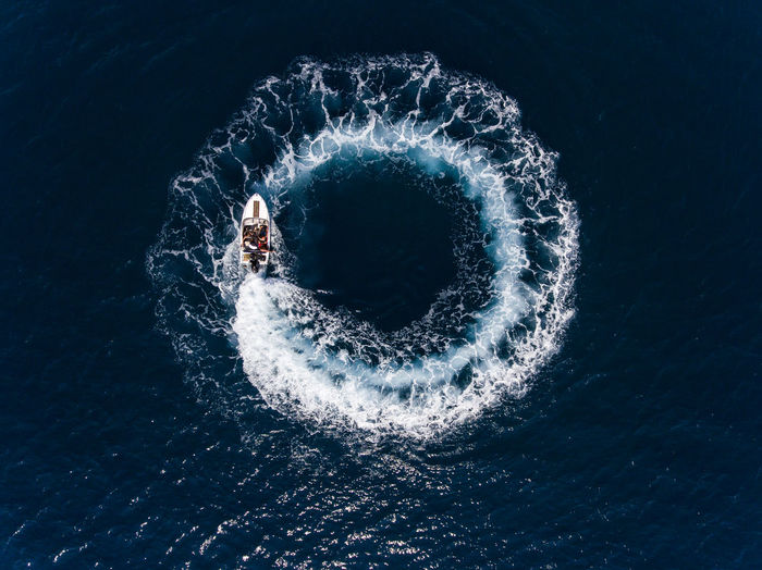 Directly Above Shot Of Boat Making Water Wake In Sea