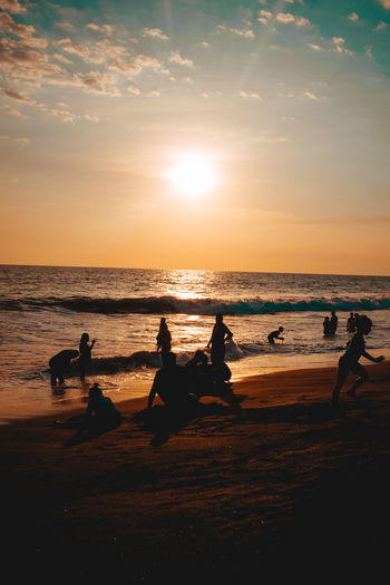 Enjoy the time with others. #explore #Adventure #enjoy Beach Silhouette Sunset Sea Reflection Water Vacations Horizon Over Water Sky Summer People Fun Sunlight Lifestyles