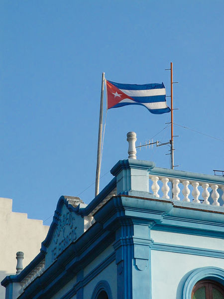 Cuban Flag on a building in Bayamo (2003) Architecture Art Blue Blue Wave Built Structure Clear Sky Colonial Architecture Cuban Flag Culture Day High Section Low Angle View No People Outdoors Sky