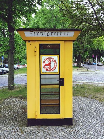 Telephone Telephone Booth Fernsprecher Yellow Fraktur Text Communication Outdoors Day Tree No People Architecture Berlin