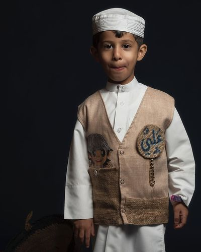 Traditional Dress Karankawa Ramadan  Qatar Indoors  One Person Studio Shot Clothing Front View Childhood Child Females Traditional Clothing Waist Up Portrait Girls Lifestyles Looking At Camera Real People Women Black Background Fashion Innocence