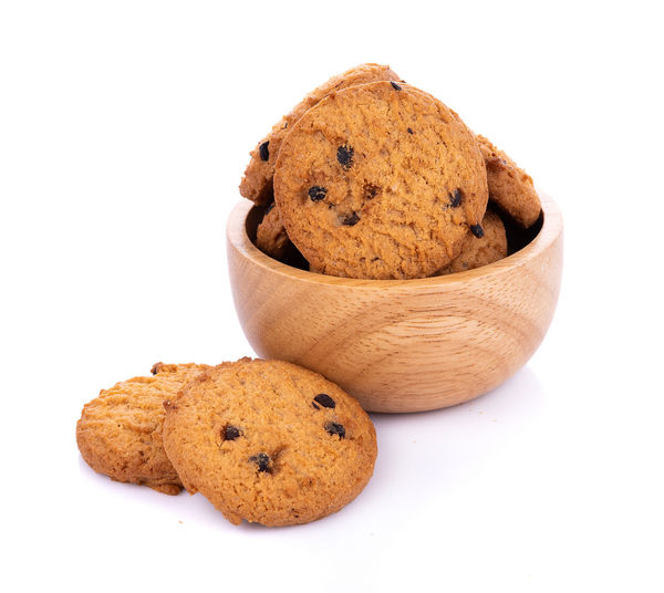Close-up of cookies in bowl on white background