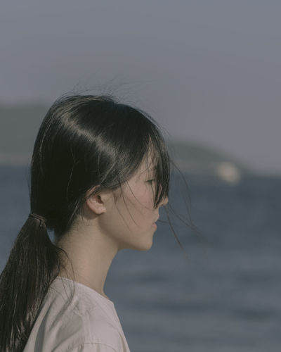 Beautiful Woman Black Hair Contemplation Focus On Foreground Hair Hairstyle Headshot Leisure Activity Lifestyles Long Hair Looking One Person Outdoors Portrait Real People Sea Sky Water Women Young Adult Young Women The Portraitist - 2018 EyeEm Awards