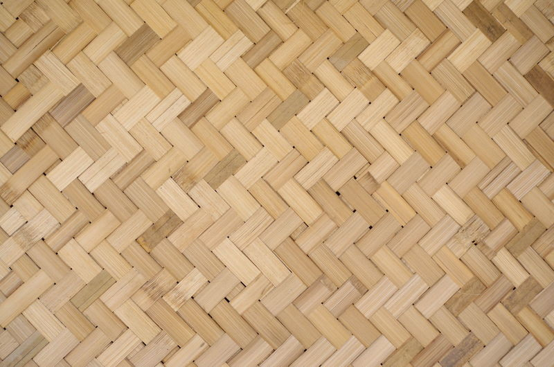 The housing wall made of bamboo. Abstract Art And Craft Backgrounds Bamboo - Material Beige Brown Clean Close-up Crisscross Design Flooring Full Frame Indoors  Material No People Parquet Floor Pattern Textured  Textured Effect Wood Wood - Material Wood Grain Woven