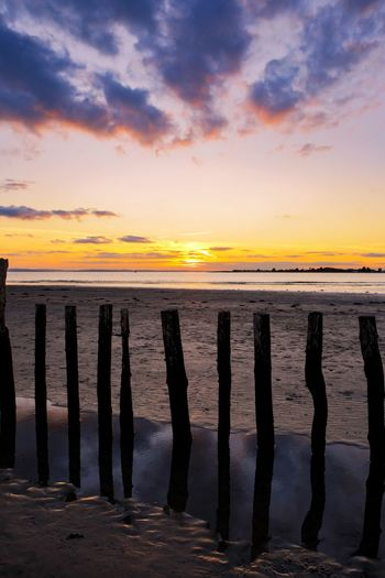 Night night Sunset Beach Reflection Water Sea Cloud - Sky Outdoors Tranquility Sand Sandy Beach Holidays Beauty In Nature Seascape Wooden Posts Seaside Screen Saver Backgrounds Scenics Shillouette Uk Wooden Low Tide