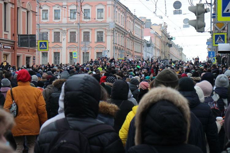 Crowd of people on street in city