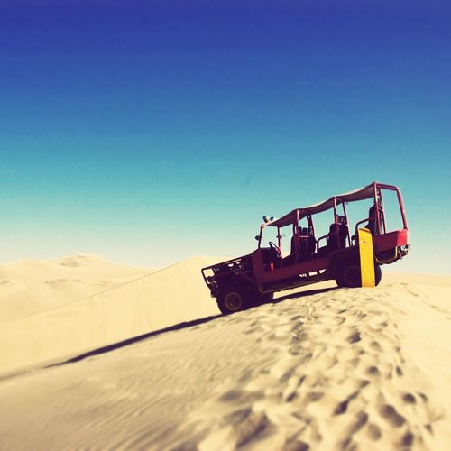 Side View Of Vehicle In Desert
