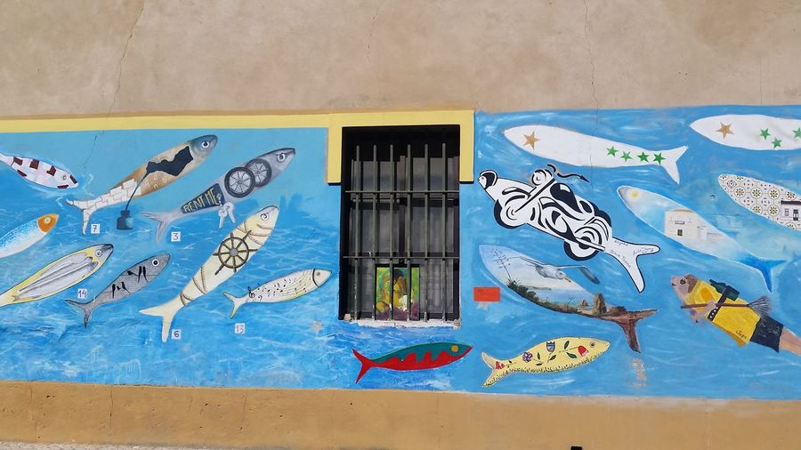 Creative Advertising Portuguese Streetphotography Portuguese Sardines Advertising Window Art The Shoal Mural Showcase June Color Of Life
