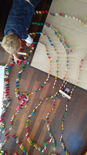 holy patience Childhood Fine Motor Skills Preschool Age Boy Playing Creative Race Car Toy Domino Patience View From Above Low Section Multi Colored Hardwood Floor