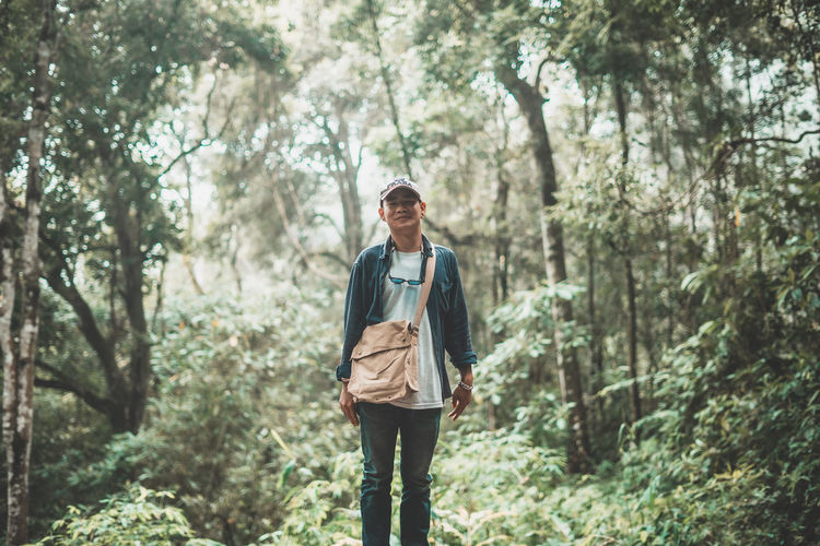 Full length of young man walking in forest