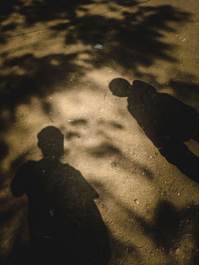 Shadow of man standing on street