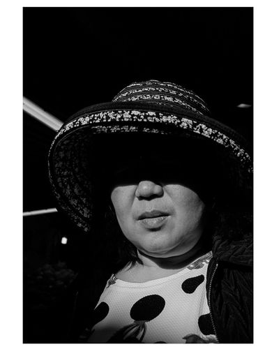 1/2 Portrait Streetphotography Streetlife Urban Streetbw EyeEmNewHere Bw Blackandwhite Child One Person Adult People One Girl Only Human Body Part Human Face Headshot Black Background Women