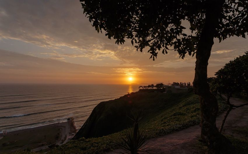 Perú sunset Sunset Tree Sky Water Sea Beauty In Nature Tranquility Plant Nature Tranquil Scene Horizon Over Water Scenics - Nature Beach Land Idyllic Dusk Outdoors No People Cloud - Sky