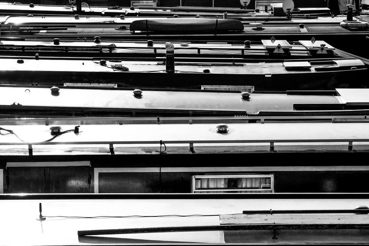 Barge BargeOnTheRiver Canal Boats In Line In A Row Lancaster Marina Narrowboats Architecture Barge Boat House Building Exterior Built Structure City Day Narrow Boat No People Outdoors Rectangle Shape Pattern Together Window
