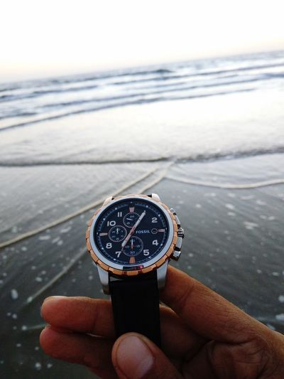 Hand Human Hand Human Body Part One Person Water Focus On Foreground Adventures In The City Sea Unrecognizable Person Day Personal Perspective Wristwatch Nature Real People Time Watch Sky Close-up Body Part Holding Finger
