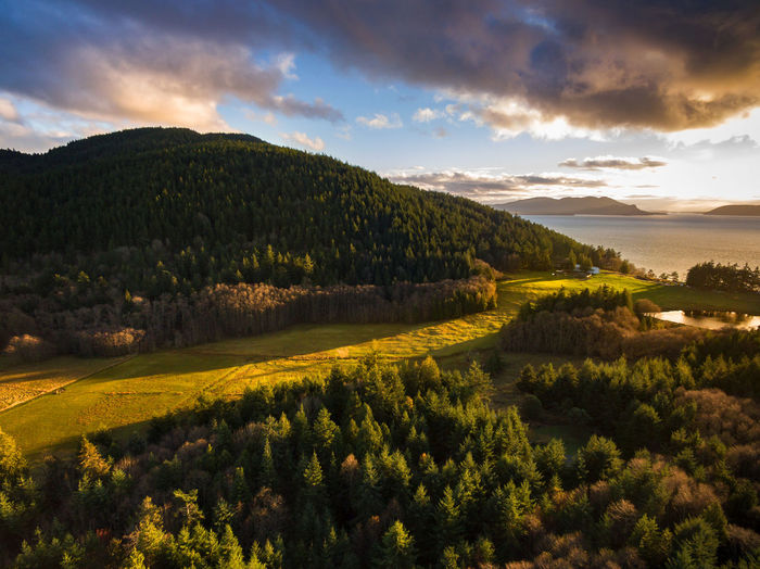 Baker Mountain Ranch, Lummi Island, Washington. This property is one of the oldest working ranches on the island. Captured during a wonderful autumn sunset. Aerial Shot Drone  Lummi Island Pacific Northwest  Puget Sound Washington Washington State Aerial View Beauty In Nature Cloud - Sky Day Destination Landscape Nature No People Outdoors Rural Scene San Juan Islands Scenics Sky Sunset Tranquil Scene Travel Destinations Tree Water