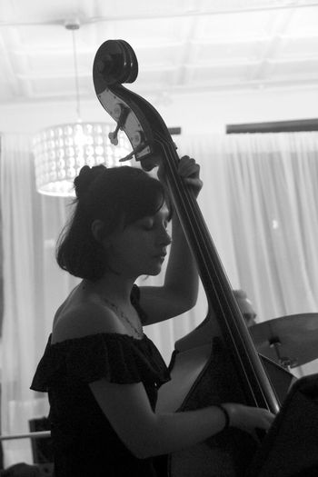 Pretty female, playing upright Bass in Jazz Quartet Music Musician Musical Instrument Musical Instrument String Performance Performer  Females Bass Black And White Playing Playing Instruments Gig Young Woman Profile Candid Teenager Teenage Girls Concert Chamber Jazz Jazz Music Jazz Concert Pretty Face Side View Analogue Sound