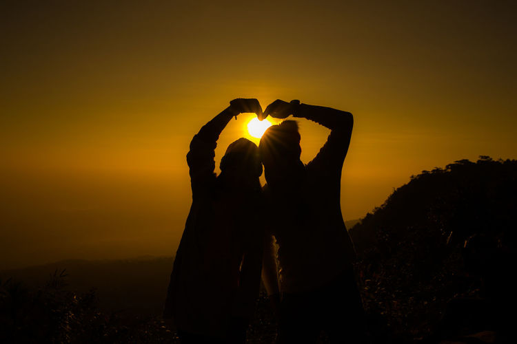 Heart Heart Shape Heart ❤ Human Arm Lifestyles Nature Orange Color People Positive Emotion Sky Standing Sun Sunset Two People