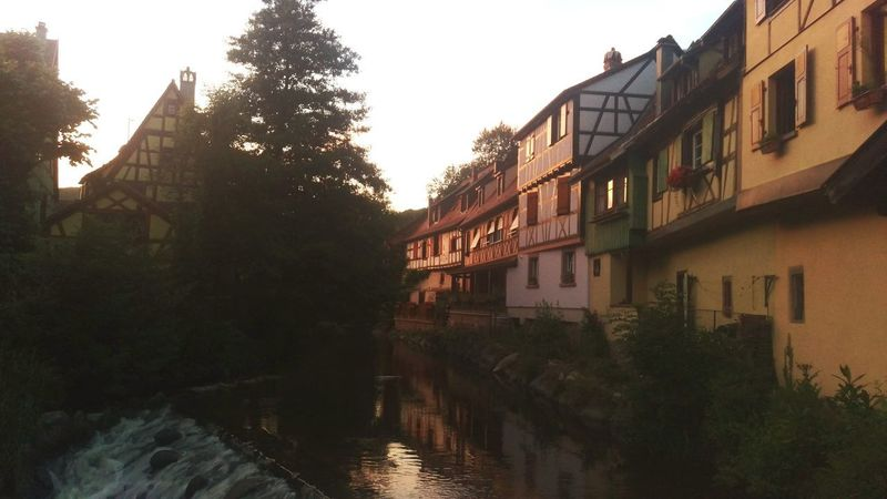 old half timbered houses in medieval French town River Town Riverside Medieval Half-timbered Houses Half-timbered Half-timber House Medieval Town Sunset