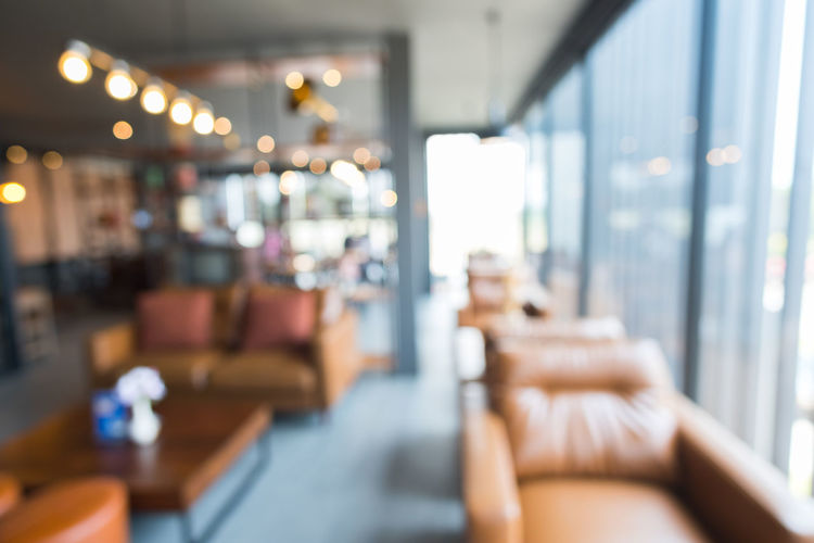 Abstract blur image of The restaurant is decorated in vintage style with bokeh for background usage. Absence Adult Airport Business Chair Day Empty Focus On Foreground Furniture Glass - Material Incidental People Indoors  Luxury Men Relaxation Restaurant Seat Sitting Table Waiting Window
