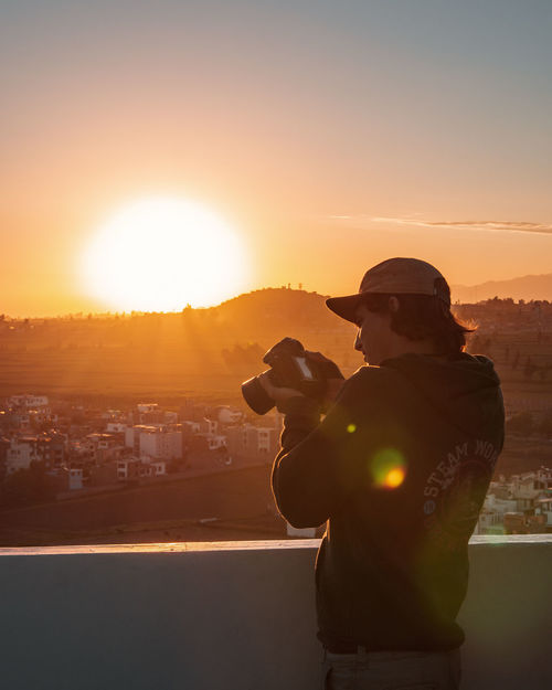 Arequipa views. Latin America Misti Casual Clothing City Cityscape Idyllic Lens Flare One Person Orange Color Outdoors Photographer Photographing Photography Themes Scenics Side View Silhouette South America Standing Sun Sunlight Sunset Technology Tranquil Scene Travel Destinations Young Adult