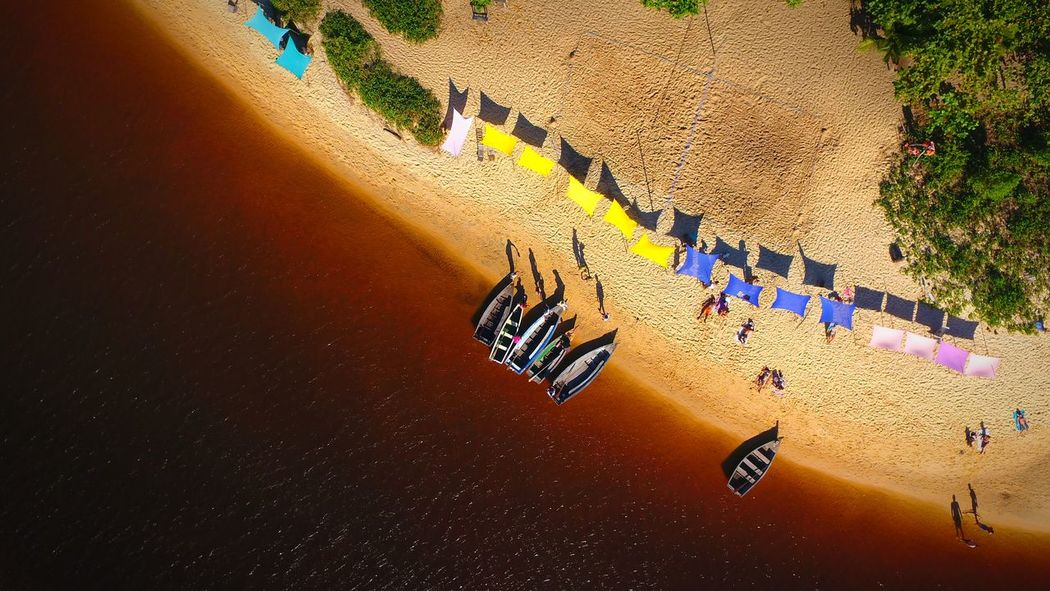 Rion Caraíva em um belo dia de sol Sun River Boat Aerial View Dronephotography Sea Life Beach Photography Beach Life Sea Caraiva Paradise High Angle View Sand Day Outdoors Shadow Sunlight Multi Colored Beach Water Nature EyeEmNewHere An Eye For Travel