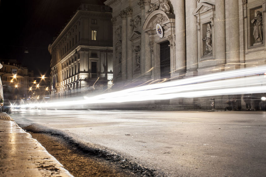 Lighting up Roman streets. Car Lights Late Night Light Nightphotography Roma Rome Architecture Building Exterior Built Structure Bus Stop City Long Exposure Night Nightlights No People Outdoors Rome Italy Street Streetphotography