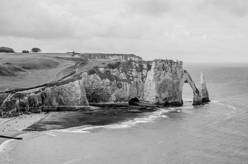//etretat Sea Water Beach OutdoorsBlack And White Friday No People Day Beauty In Nature Nature Horizon Over Water Sky France étretat Etretat Cliffs Cliffs EyeEmNewHere Nikon Clouds Nature Normandy, France Rock View